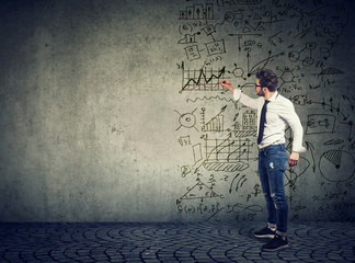 Businessman standing and drawing business ideas