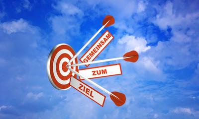 Pfeile auf Zielscheibe im Wolkenhimmel. Konzept zur Motivation. Mit Text in Deutsch: Zusammen zum Ziel.  3d render