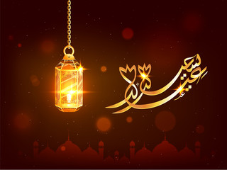 Arabic calligraphic golden text Eid Mubarak with crescent moon, mosque and hanging lanterns on brown background.