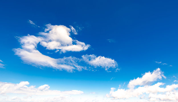amazing cloud formations on a bright blue sky. beautiful cloudscape in summer