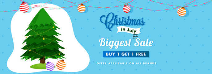 Website header or  banner  design for Christmas in July fest with Xmas tree, and hanging Christmas balls on blue background, with Buy 1 and Get 1 Offers.
