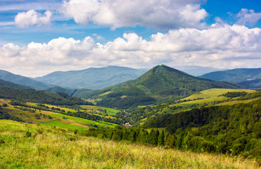 Abranka village in the valley of Carpathian mountains, Ukraine. lovely countryside scenery in early autumn with clouds distant ridge.