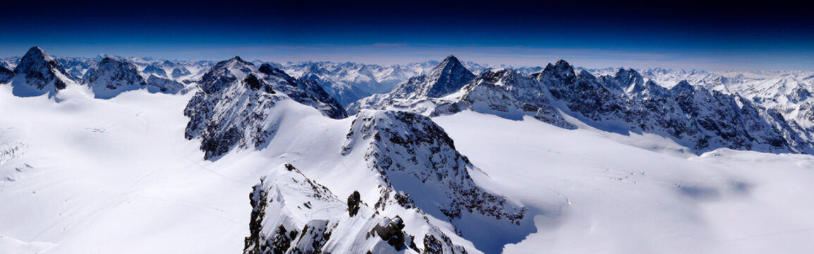 fantastic winter mountain panorama with a view of the high peaks and glaciers of the Silvretta mountains in the Swiss Alps on a beautiful winter day