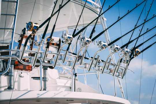 Sport fishing boat with fishing rods in holder and tower