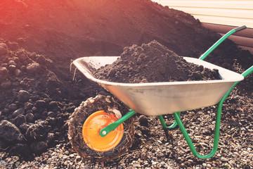wheelbarrow with black soil