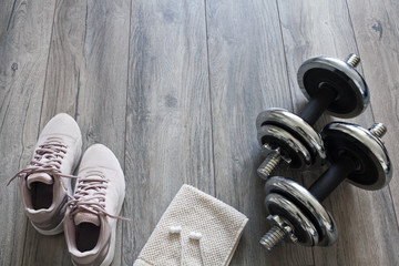 dumbbells on a wooden floor