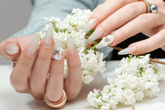 Amazing 3d Flower nail art design on tinted glass nails.