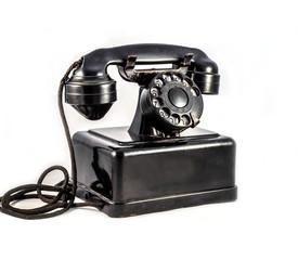 Old vintage black phone on white background