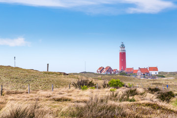 Panorama with red lighthouse at  wadden island Texel in the Netherlands taken form the sand dunes of teh village Cocksdorp.