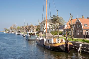 Harbor Dutch city Medemblik with old historical wooden sailing ship
