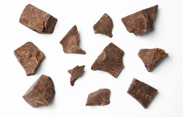 Composition with delicious chocolate chunks on white background