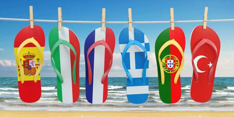 Hanging flip flops in colors of flags of  different mediterranean european countries Spain, Italy, France, Portugal, Greece and Turkey. Travel and tourism concept.