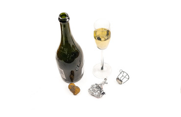 Open bottle and glass with champagne