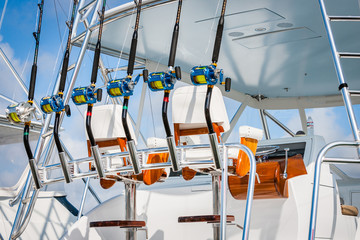 Sport fishing boat side view of helm station, track seat, and colored reels 2