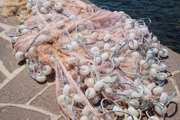 Multi-colored nylon fishing nets and floats