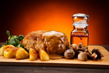 Stuffed pork chop with boiled potatoes and vegetables
