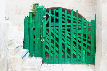 Leuca, Apulia - An old handmade green folding gate in a fortress