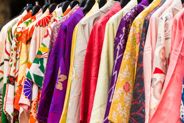 Sale of colorful kimonos on the city street in Kyoto, Japan. Close-up.
