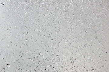 Water drips on silver surface.Abstract background.