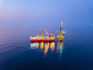 Aerial View of Tender Drilling Oil Rig (Barge Oil Rig) in The Middle of The Ocean at Sunset Time