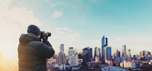 Wall Mural - Tourist taking photography of Bangkok city in sunrise. Urban travel lifestyle