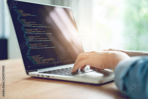 Closeup coding on screen, Woman hands coding html and