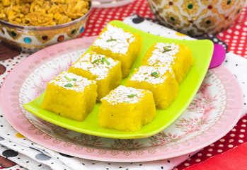 Indian Sweet Kopra pak Also Know as Barfi is a Gujarati style of making coconut burfi. This sweet or mithai is made from freshly grated coconut, sugar, milk and mawa.