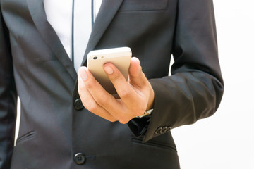 Business man texting on smartphone hand close up technology concept