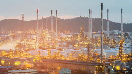 Night oil refinery aerial view with mountain background