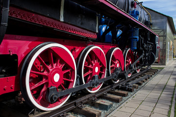 Wheels of red color of the old locomotive