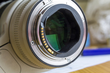 Close up of camera lens on blurred background.