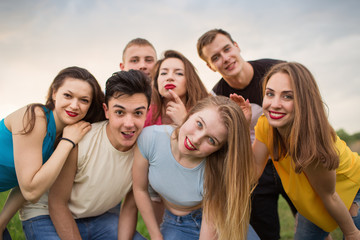 Group of happy young people laughing
