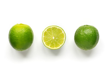 Isolated limes. Row ripe citrus on white background.