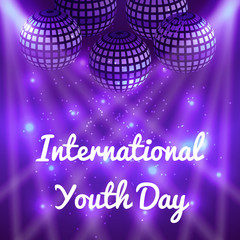 International Youth Day. 12 August. Mirror balls for parties with rays, purple blur background