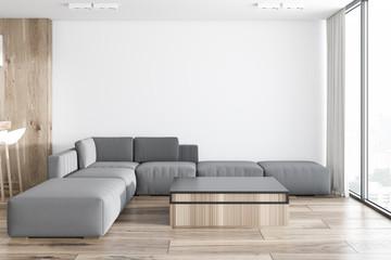 White living room in studio apartment, sofa