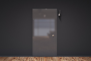 Closed door in a gray wall room