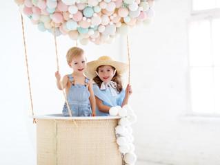 happy children in a fairy magic hot air balloon