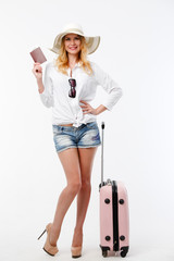 Image of tourist woman in hat with passport and tickets, suitcase