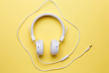 Photo of white headphones for music on clean background