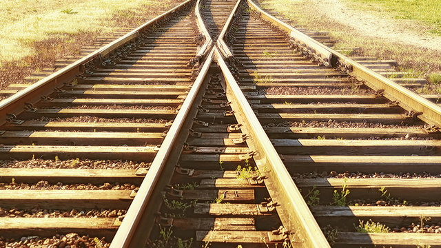 A railway track litted by the sun.