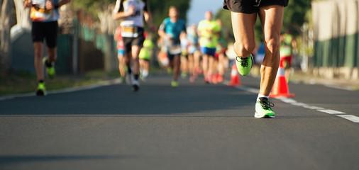 Marathon running race, people feet on city road Wall mural