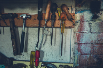 Various tools on wall in shed