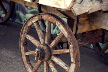 Old cartwheel of horse drawn wooden cart