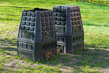 two black dry grass containers for composting