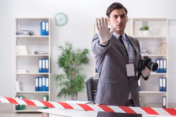 Forensics investigator at the scene of office crime