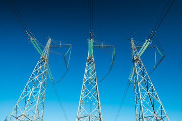 Electricity pylons in wide angle perspective, high voltage power lines, background photo, minimalism art