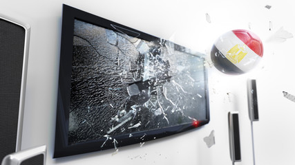 Soccer ball with the flag of Egypt kicked through a shattering tv screen.(3D rendering series)