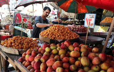 Products are displayed at a vegetable market in Cairo