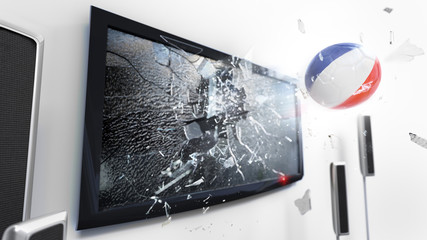 Soccer ball with the flag of French Guiana kicked through a shattering tv screen.(3D rendering series)