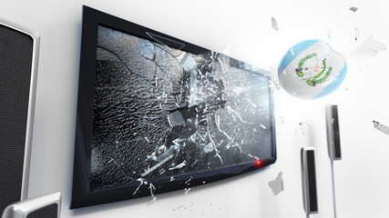 Soccer ball with the flag of Guatemala kicked through a shattering tv screen.(3D rendering series)